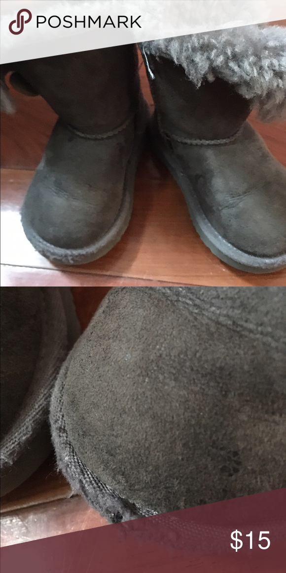 Toddler Uggs size 6c Fair condition, it has torn in one of the boots as shown in pictures UGG Shoes Boots