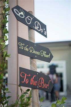 Directional chalkboards are a great way to direct your wedding guests to the ceremony, cocktails, dancing, and reception