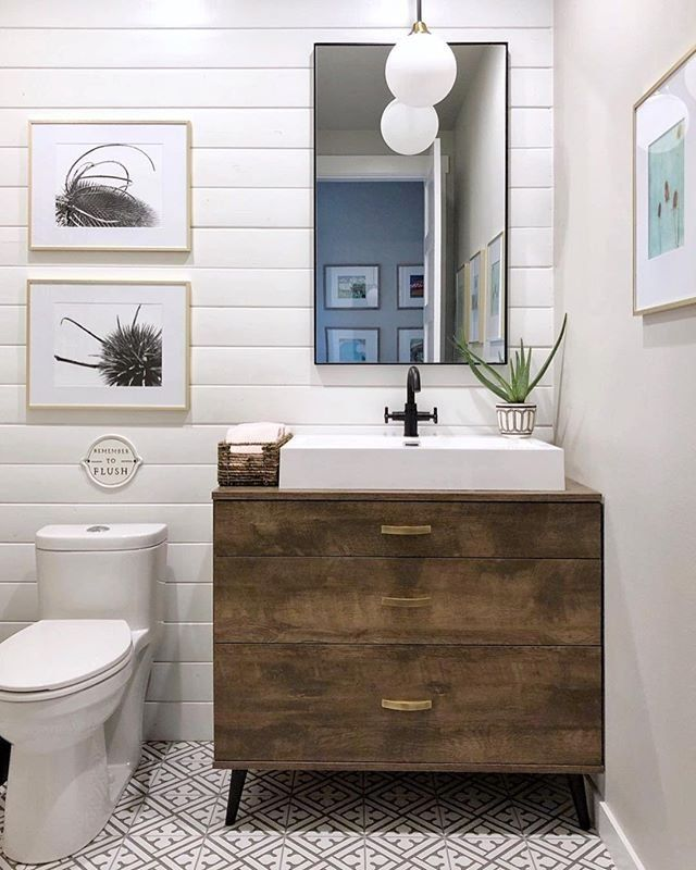 Shiplap walls, wooden vanities, tiled floors, oh my! @kristin_kgdesigns's bathroom is making all our textile dreams come true. Shop similar products via the link in our bio. #WayfairAtHome