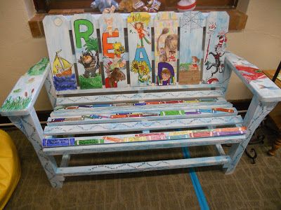 I love this reading bench that incorporates so many popular books into the painting.