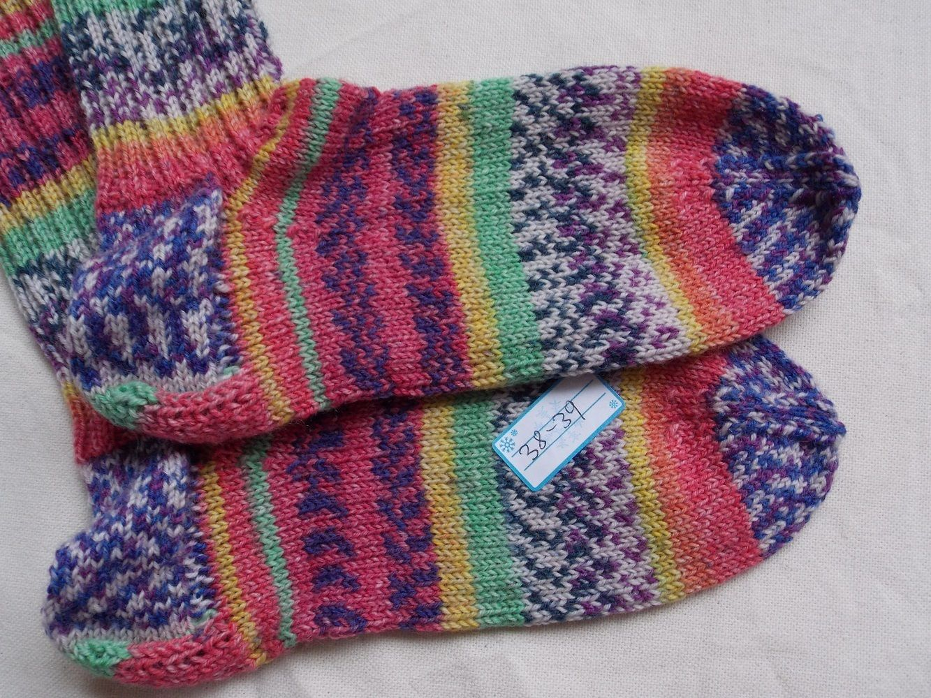 """This pair of socks I have knitted from a special Opal sockyarn. The yarn used, is dyed after the painting """"good morning city"""" of the austrian painter Hundertwasser."""