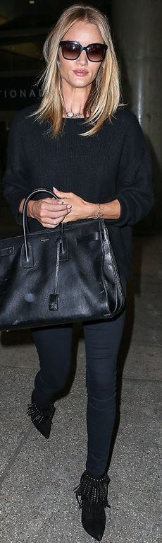 Who made Rosie Huntington-Whiteley's jewelry, sweater, black skinny jeans, studded fringe suede boots, and leather handbag?