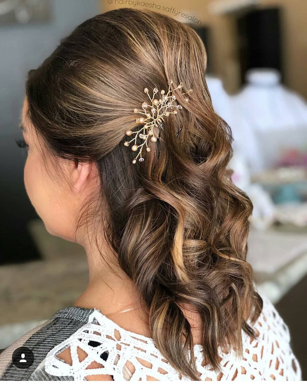 half up half down wedding hairstyle with curls rose gold