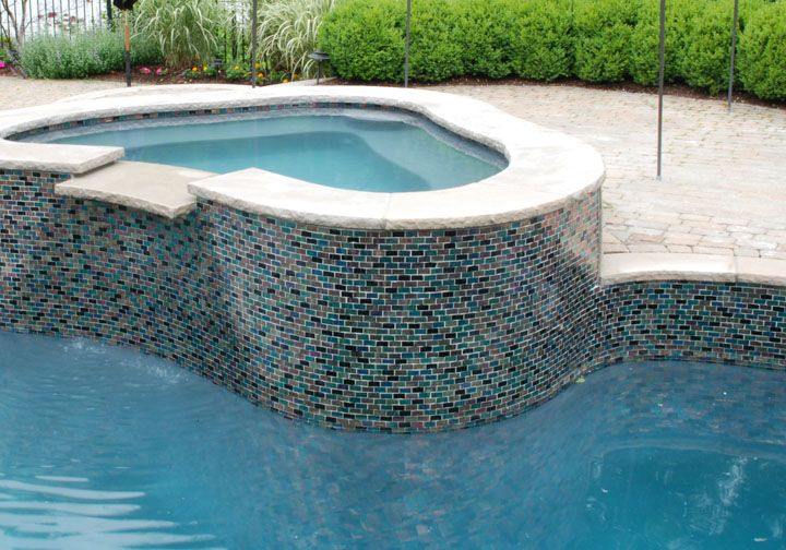 Latest Pool Glass tiles at the waterline are the latest trend.