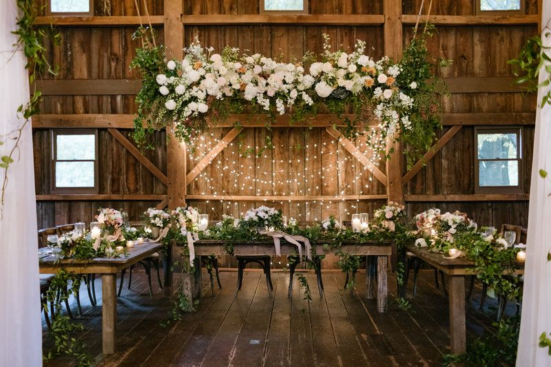Beautiful greenery paired with floral and twinkly lights