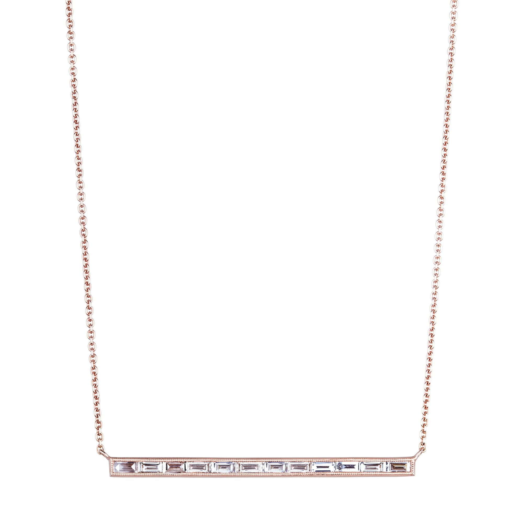 and attractive slightly brilliant line cut composed graduated a of emerald baguette diamond necklace pin