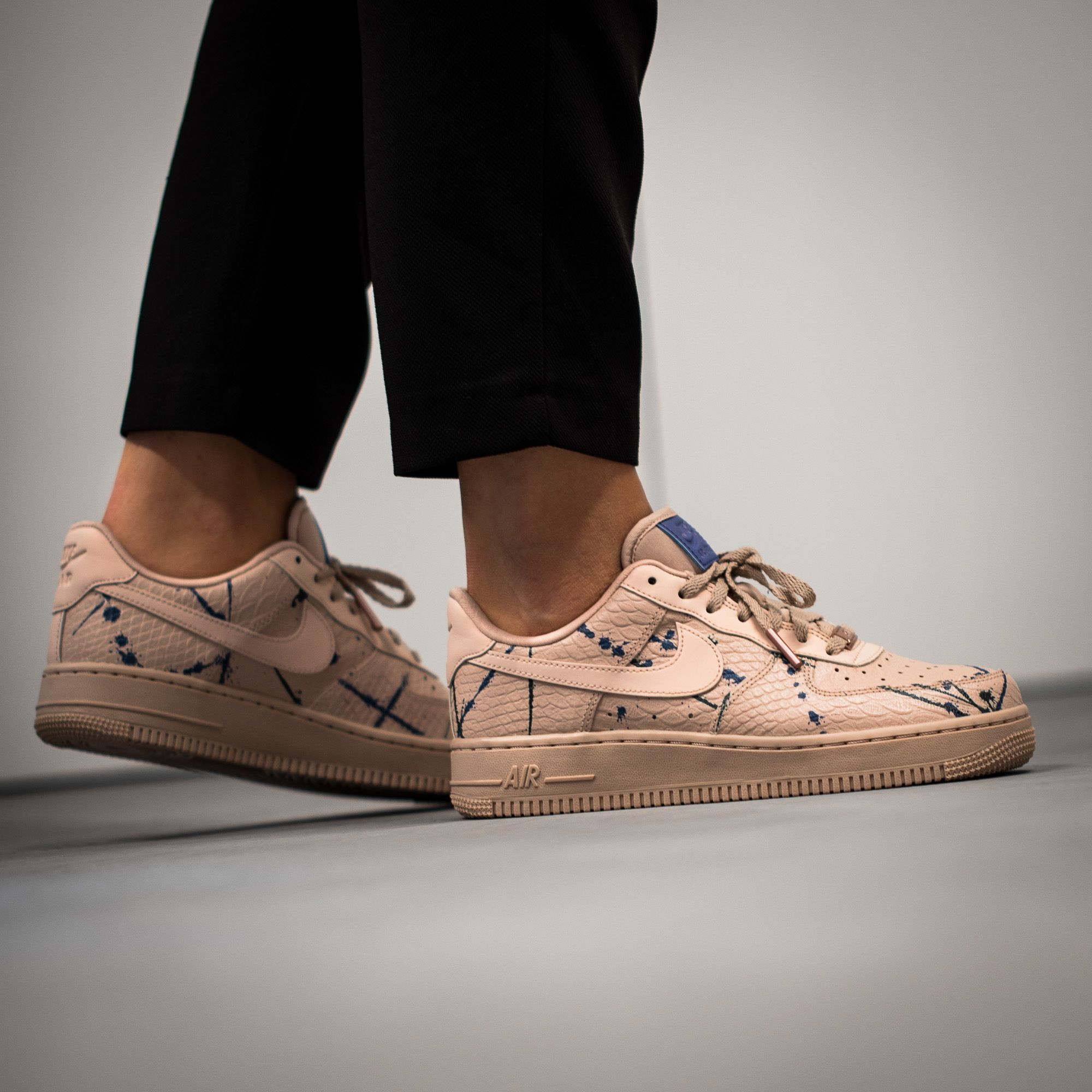 770de8586476 This Nike WMNS Air Force 1  07 LX for Women adds Premium Snakeskin and  Splatter