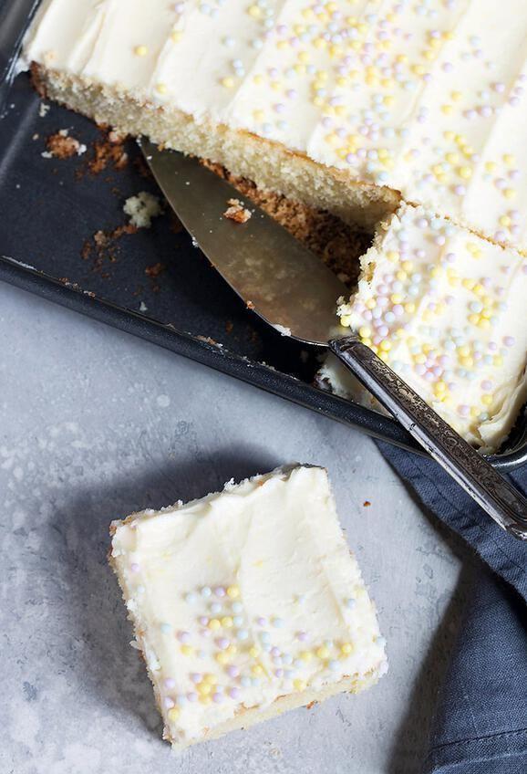 Lemon Sheet Cake with Lemon Buttercream Frosting #lemonbuttercream Moist and light lemon sheet cake with lemon buttercream frosting #lemoncake #sheetcake #seasonsandsuppers #lemonbuttercream Lemon Sheet Cake with Lemon Buttercream Frosting #lemonbuttercream Moist and light lemon sheet cake with lemon buttercream frosting #lemoncake #sheetcake #seasonsandsuppers #lemonbuttercream