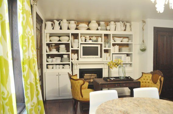 Painted large pieces on top of kitchen cupboard. Wall above cupboard same great as cupboards; objects citron-yellow or white. Sofia Berger Interiors NYC. House Tour: Sofia's DIY Garden Apartment in Brooklyn | Apartment Therapy