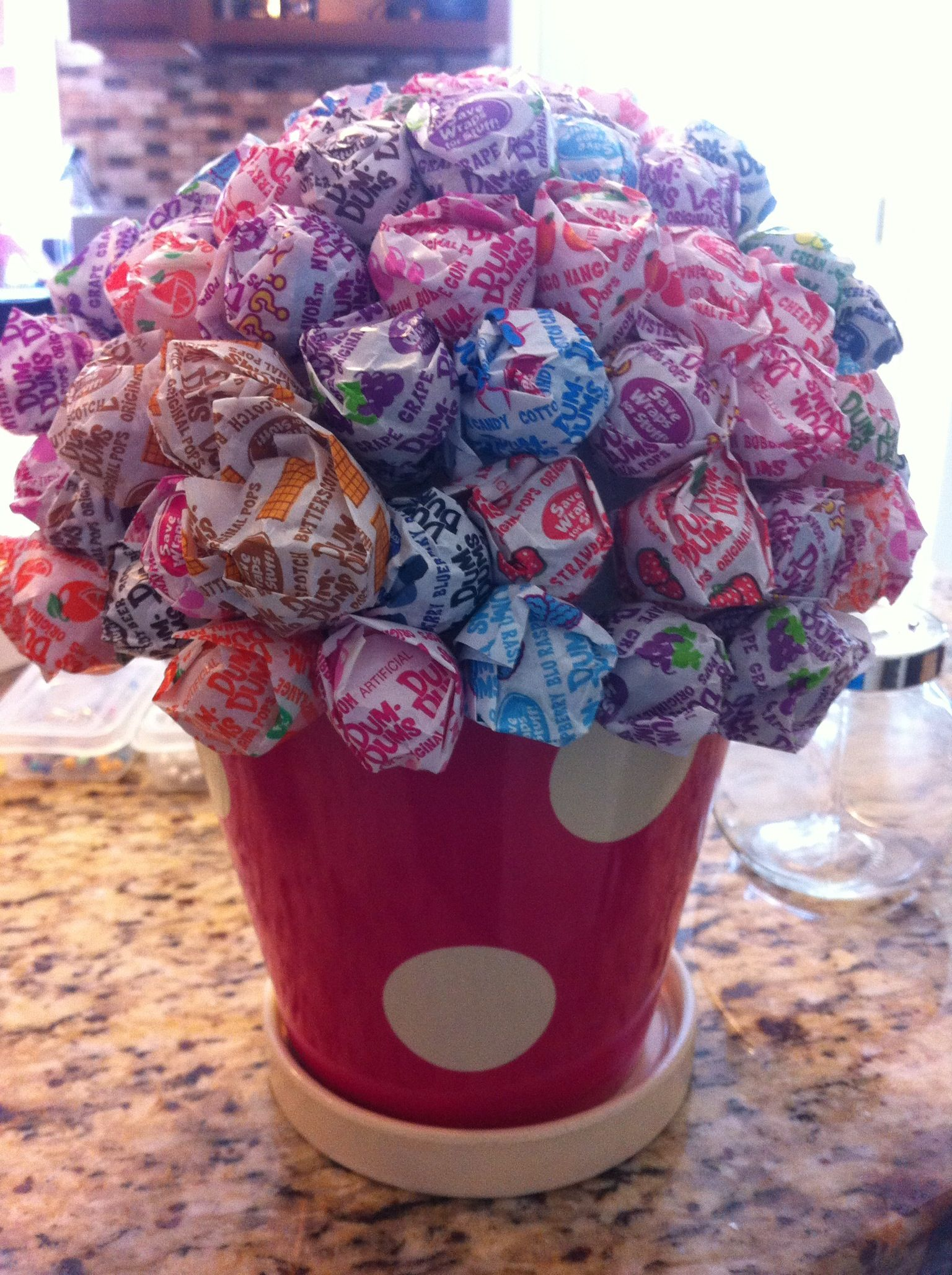 Lollipop flower planter used a ball styrofoam in a cheap planter lollipop flower planter used a ball styrofoam in a cheap planter and poke the dums dums until it was all filled izmirmasajfo
