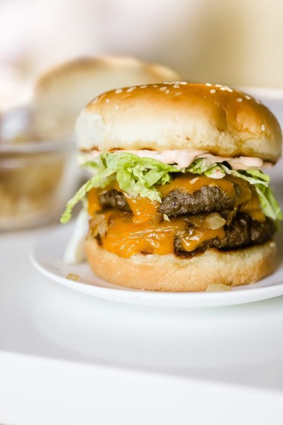 Homemade In N Out Burgers Recipe! Here's a lighter and lower calorie take on In N Out's famous double double burgers, including their delicious secret sauce!