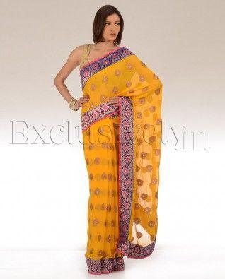 #Exclusivelyin, #IndianEthnicWear, #IndianWear, #Fashion, More Mustard Sari With Paan Leaf Motif