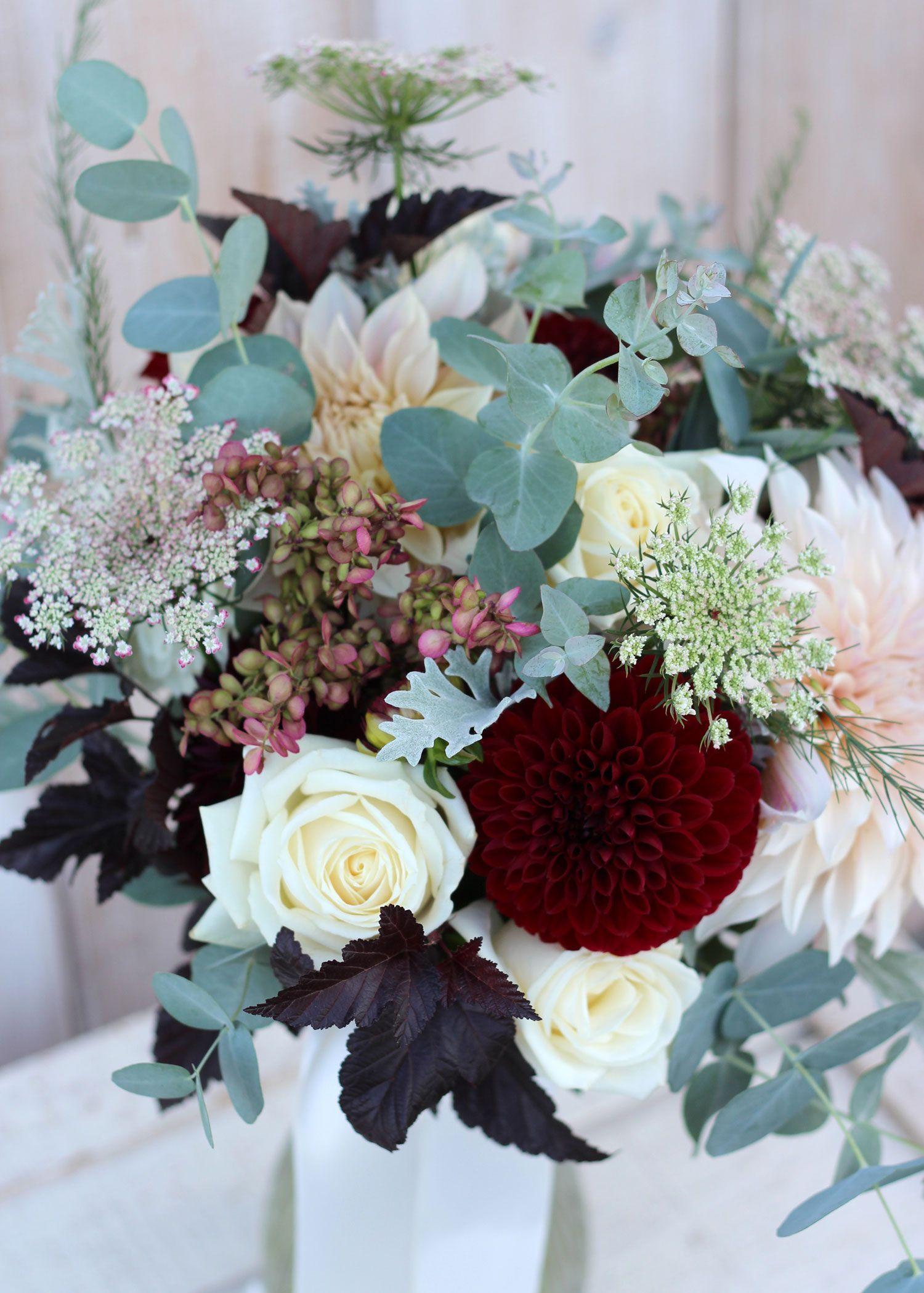 Bride bouquet cafe au lait dahlia with cranberry accents