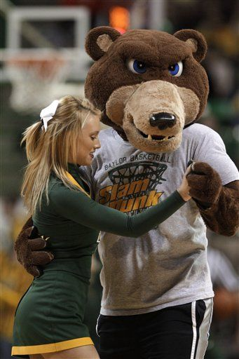 A Member Of The Baylor Cheerleading Squad Dances With The University