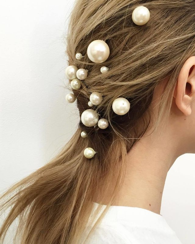 A pinned-back low ponytail is made insanely elegant with pearls. -