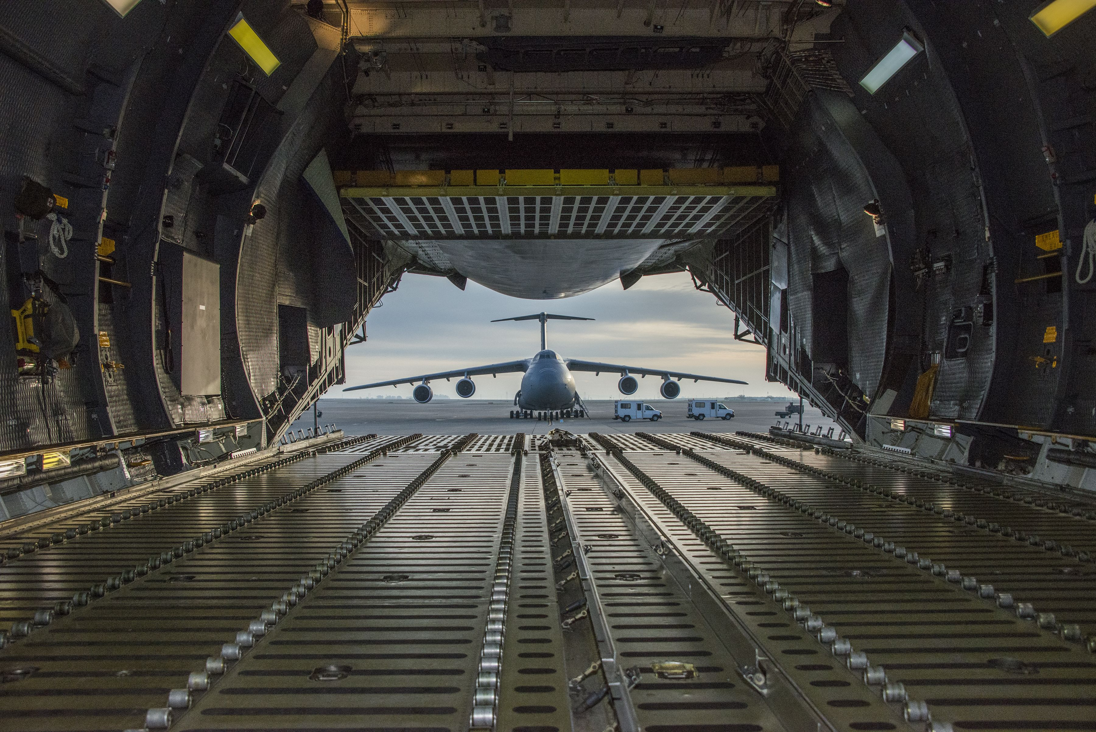 A C5 Galaxy is framed by the opened aft cargo door of