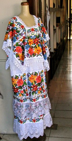 c0c8683299 An especially beautiful example of a terno de gala. The garment gets its  name