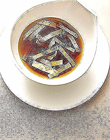 Photo of Clear beef broth with pancake strips and beef …