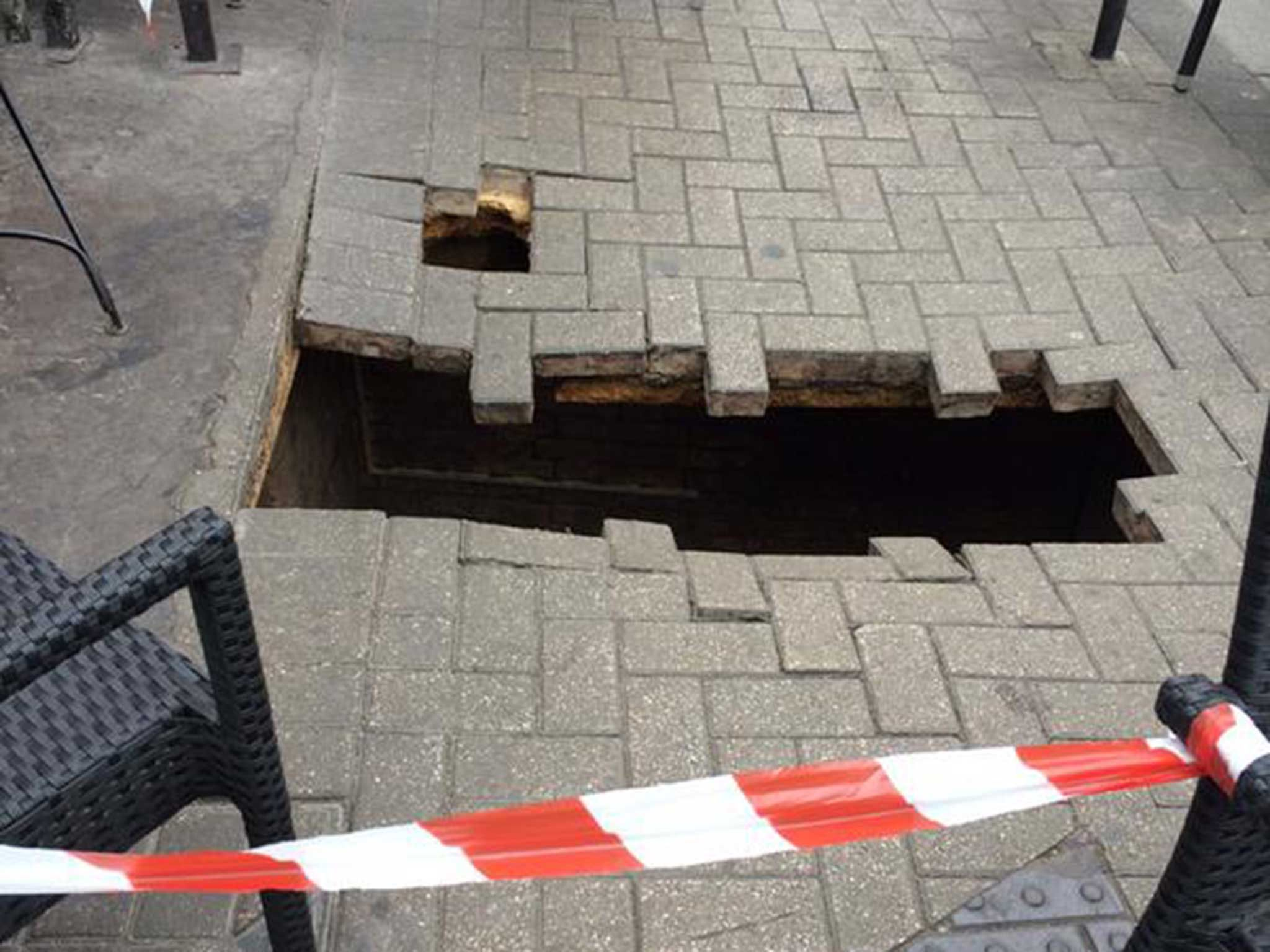 Fulham (London) 2015 - Dramatic events unfolded in west London today after a woman fell into a hole possibly masquerading as a sinkhole.