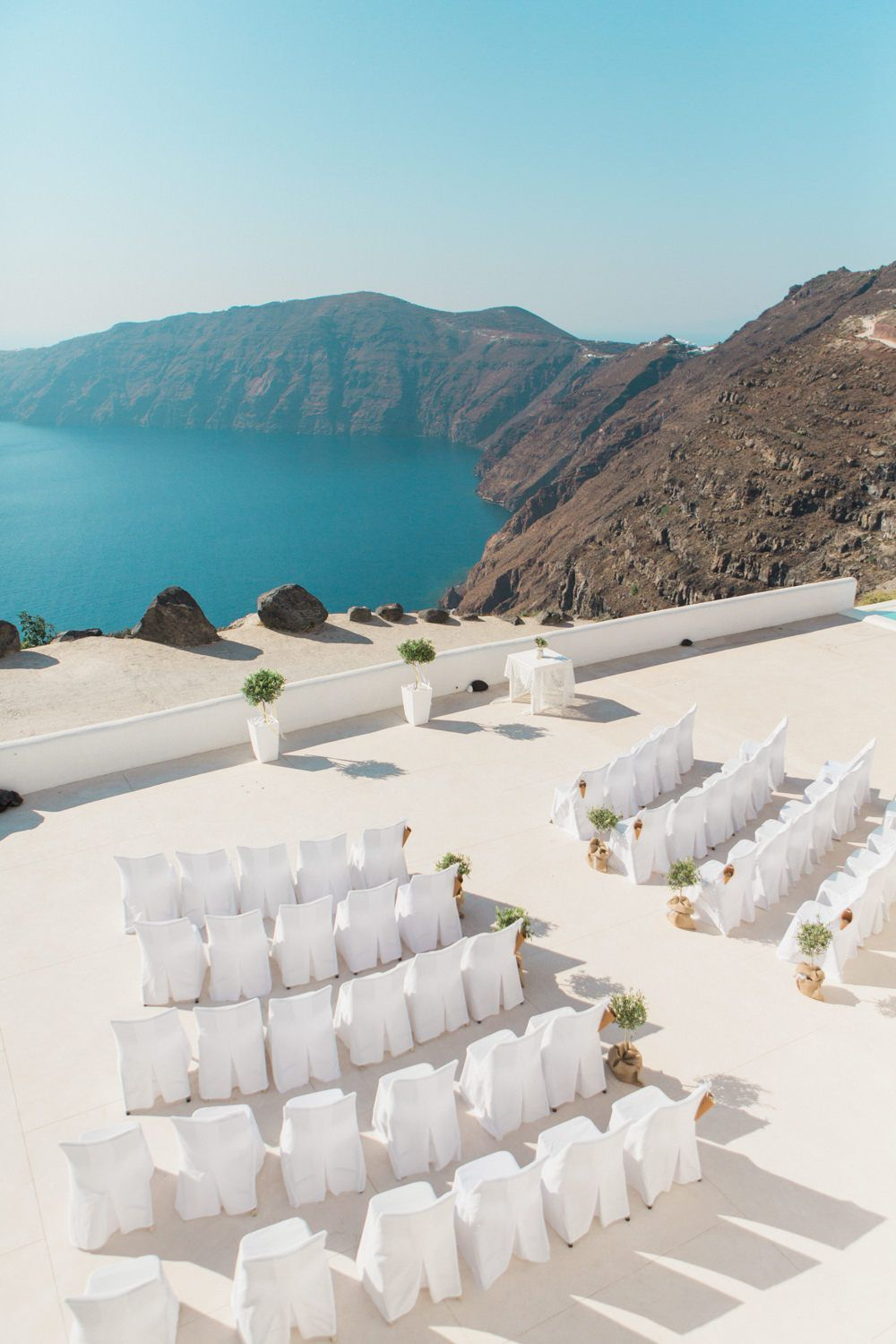 Beach wedding decorations elegant  Elegant Santorini Wedding at Rocabella Hotel with Olive Tree Decor