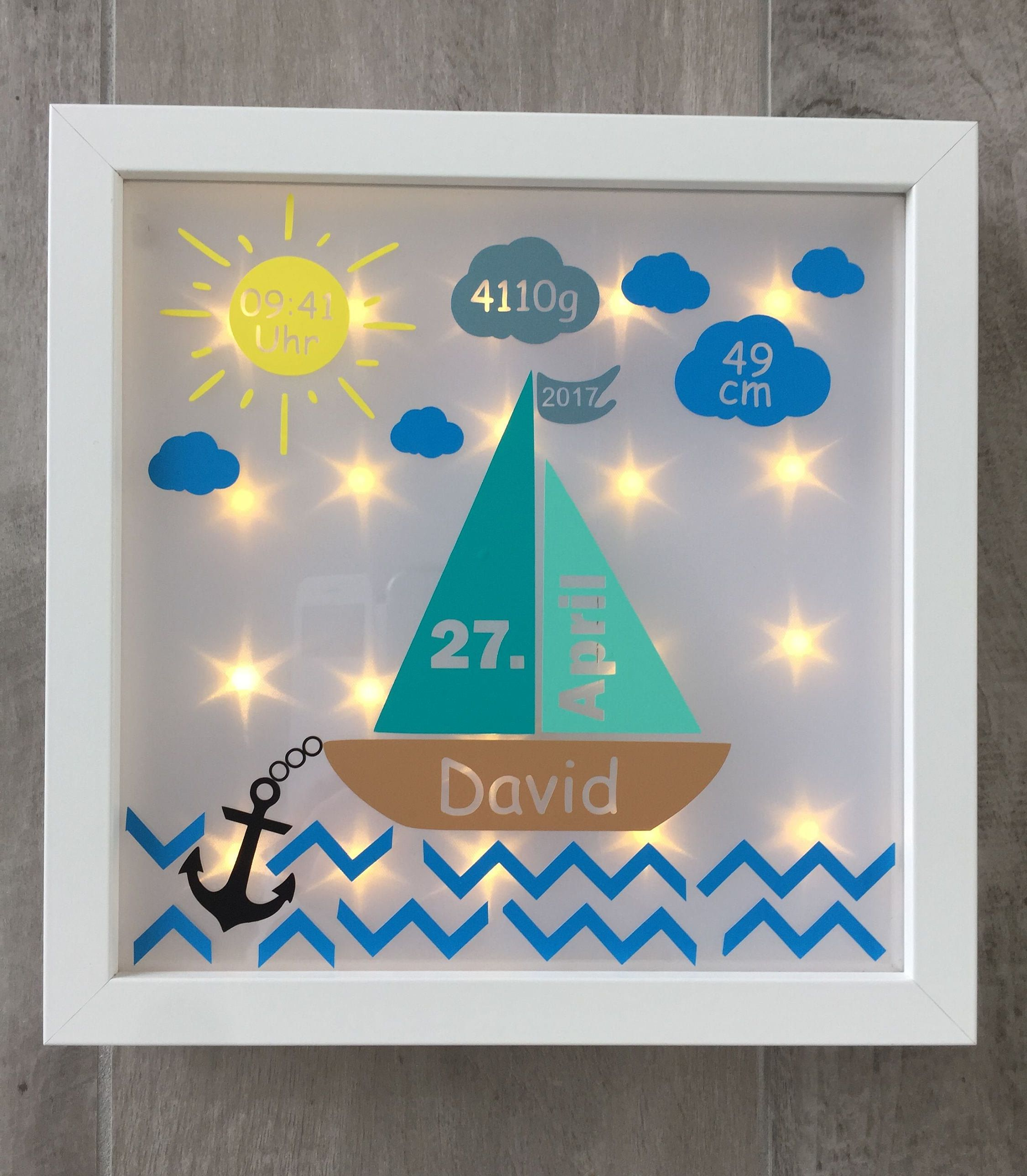 Illuminated picture frame with sailing boat and dates of birth ...