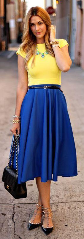 Yellow top, blouse, blue plated skirt, handbag, black heels ...