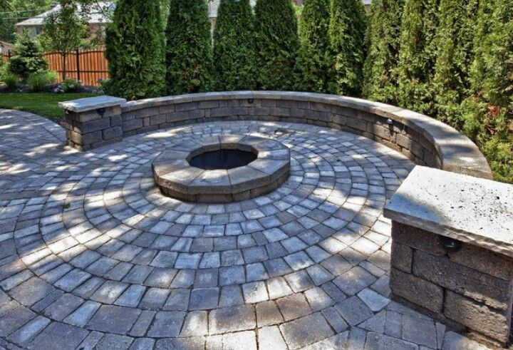 Paved Patio With A Firepit A Half Circle Bench And Privacy Planting Paver Fire Pit Rustic Fire Pits Fire Pit Backyard