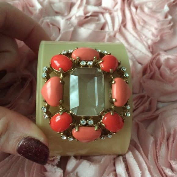 NWT Jewelry Cuff This really pretty jewelry cuff is a great statement piece for any outfit. Brand new with tags, never worn just for this picture. It's got salmon colored beads that add a great pop of color! Jewelry Bracelets