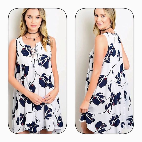 Hi lo lace up swing dress! This sleeveless woven dress features bold floral print all over, a lace up detail on upper front and a flowy swing fit. Dresses