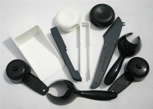 Tupperware Lot of Gadgets in Black & White by Tupperware. $9.00. One Squared Canister Scoop, Set of Salt & Pepper Shakers. Two Black Mini Funnels, Black Toaster Tongs, White Toaster Tongs. Black Cheese Slicer, Two Black Hard Boiled Egg Retrievers. These Gadgets are very useful to have in the kitchen for your everyday use.