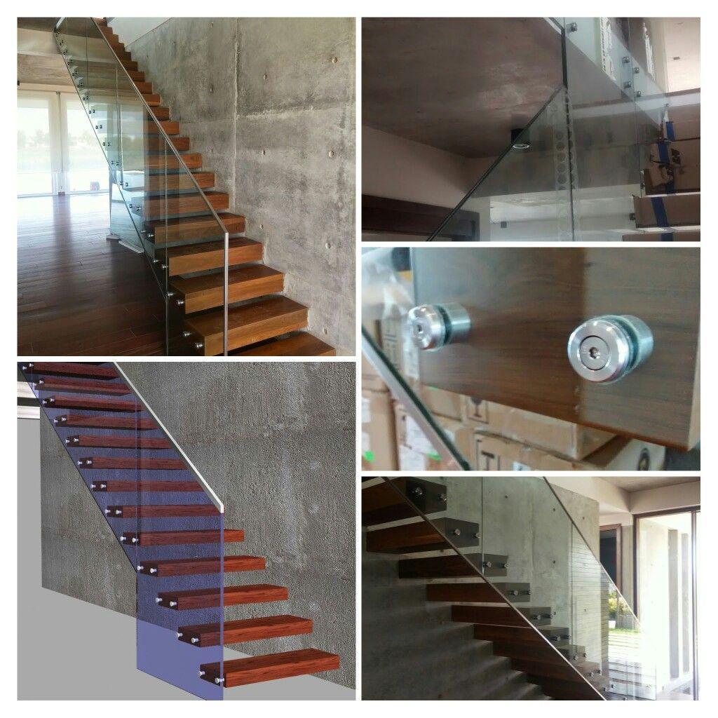 Escalera suspendida con baranda de vidrio y detalles en acero inoxidable. ABC-INOX