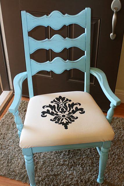 The refinished chair has a Silhouette painted on the the fabric covered seat. You can even print your own design and create a stencil.