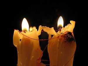 A Fixed Candle Spell In Which Two Candles Have Been Tied Together And Set In Place To Burn Together Candle Spells Candles Candle Magic