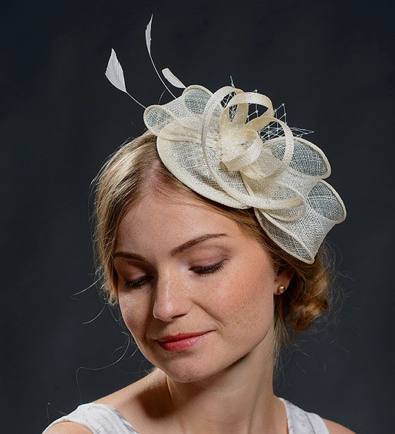 Items similar to White wedding fascinator hat for your special occasions-New fascinator style in my shop on Etsy