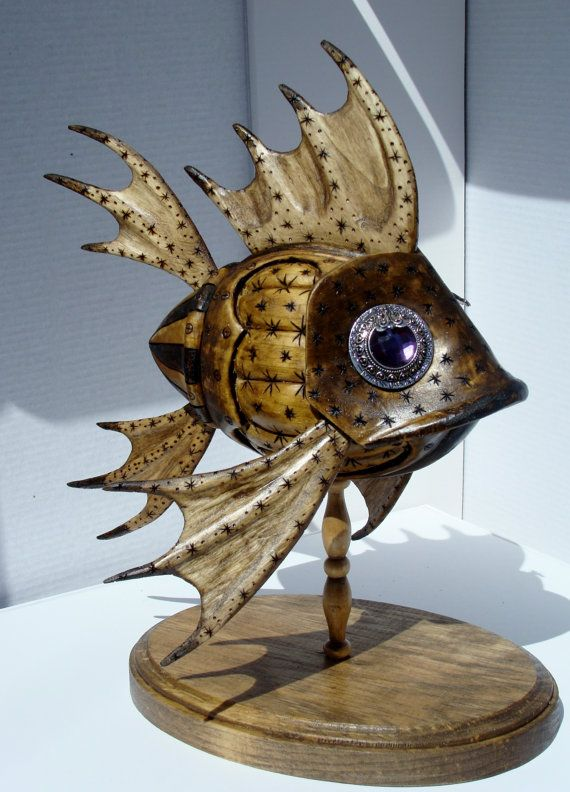 Wooden fish with purple crystal eyes.
