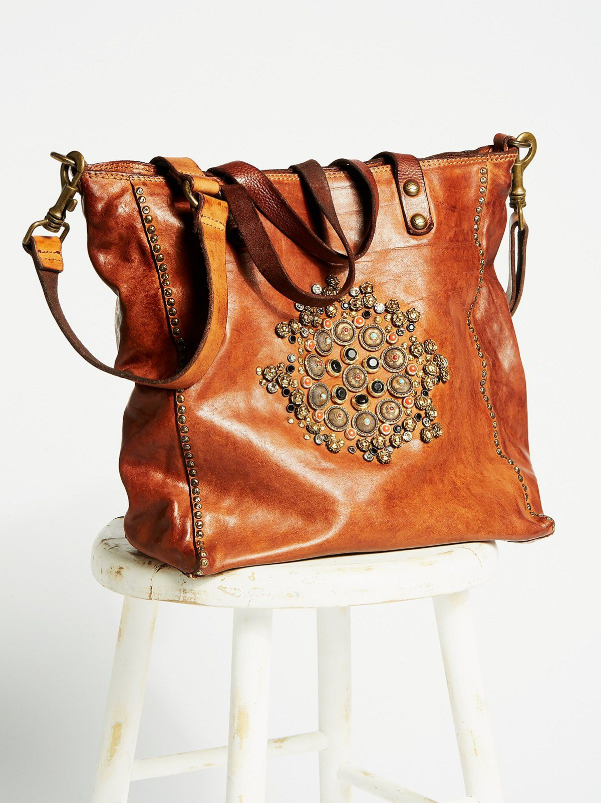 Capri Embellished Tote   Made from luxe Italian leather, this tote bag is  beautifully embellished with metal stud and sparkly stone detailing with  metal ... 7bd535173a