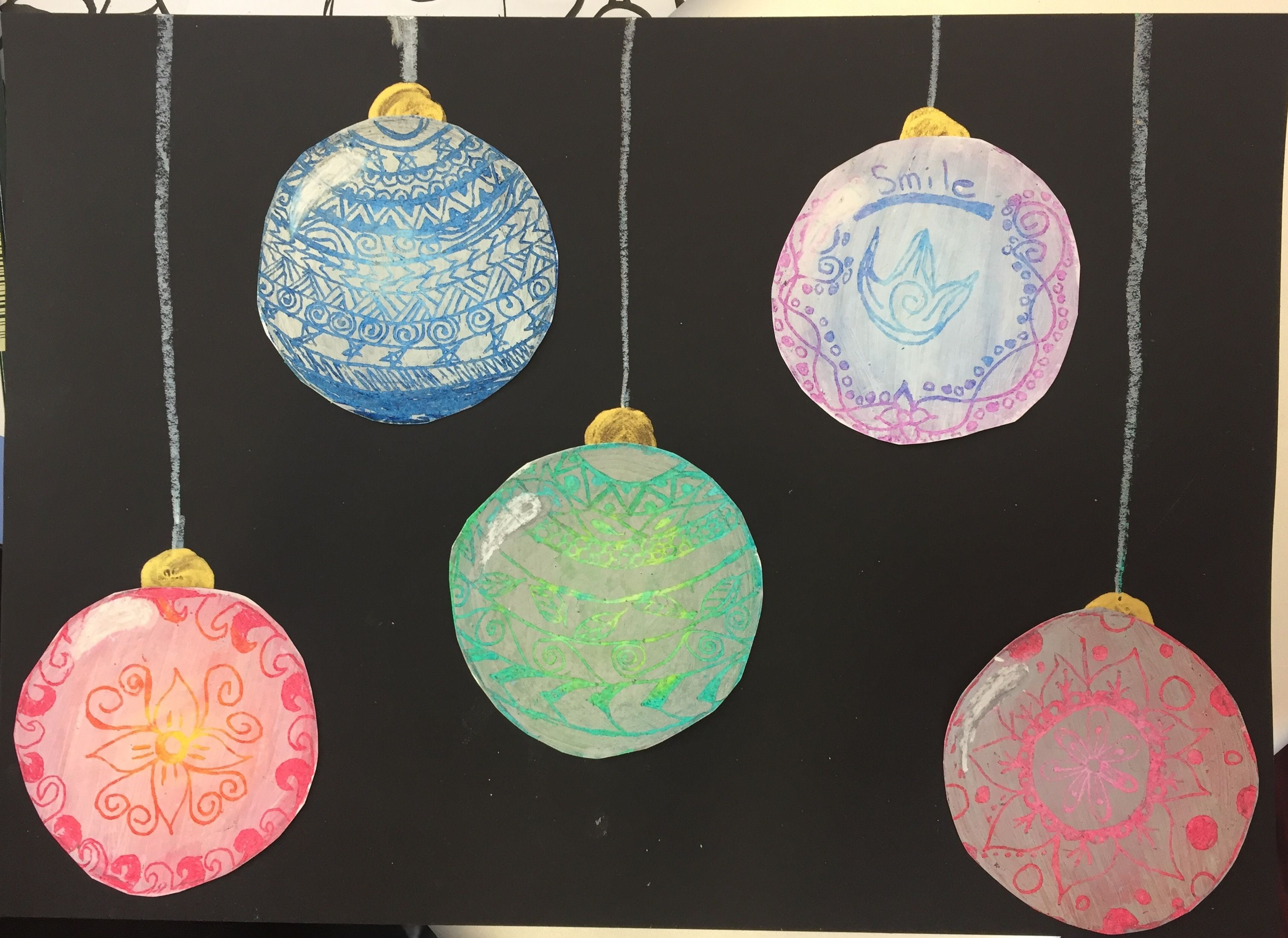 Christmas baubles oil pastel gesso etching on black paper