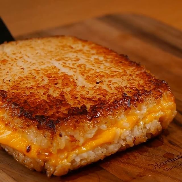Don't forget to like and tag your friends! ❤️ .  Don't know what to do with leftover rice? Grilled Cheese Rice Sandwiches are the bomb! Gooey melted cheese on grilled rice accented with just a hint of soy sauce. Full recipe can be found at TabiEats. Click link in profile for more videos like this.#foodinstagram #followme