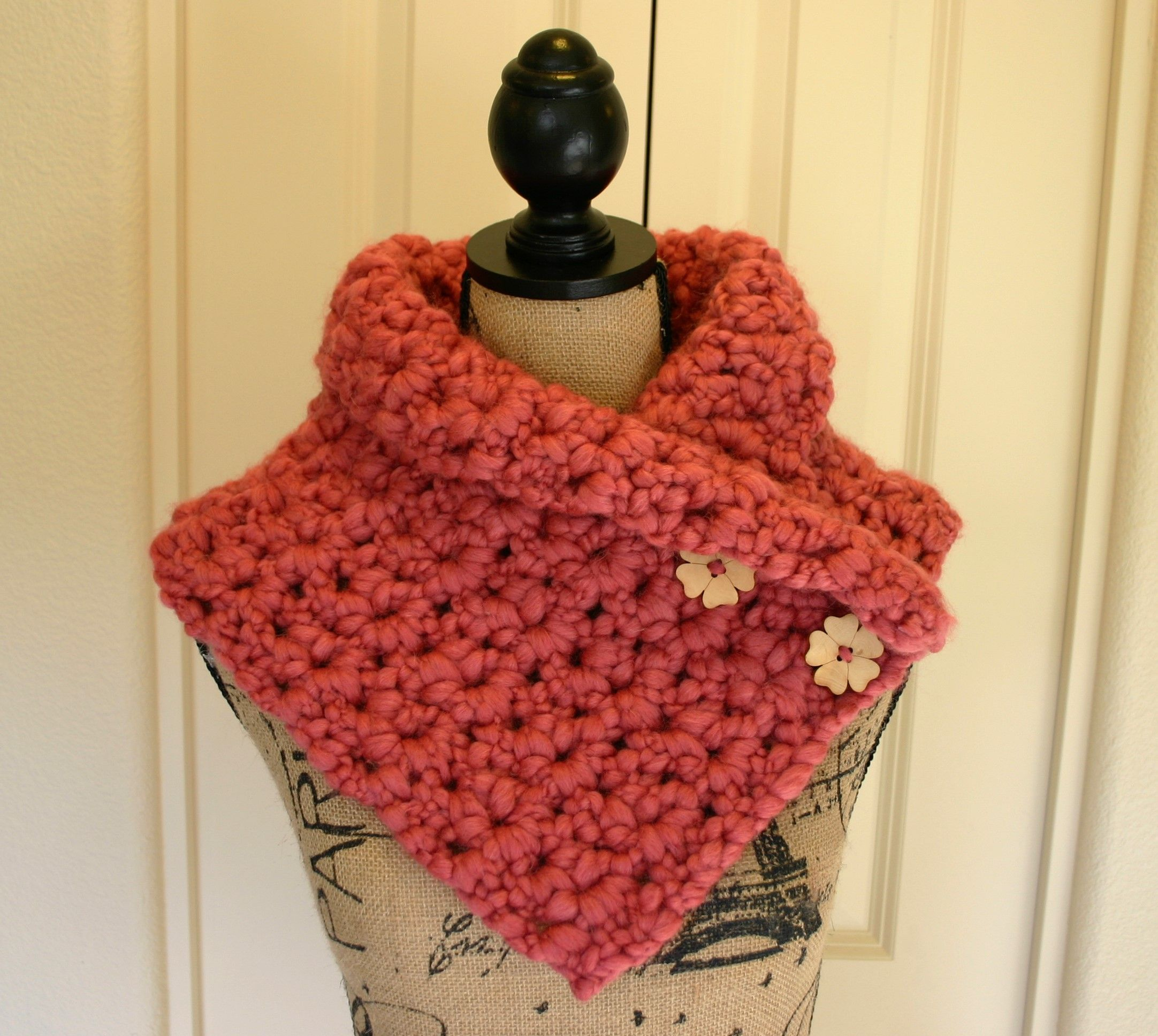 The La Vie En Rose Cowl is a soft, chic accessory conjuring up thoughts of springtime in Paris. Crocheted with lofty cobbled yarn, this dreamy pink-colored cowl is warm and stylish. The cowl is accented with two wooden flower buttons.