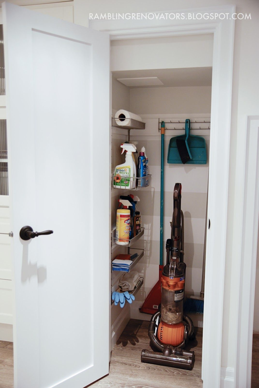 Broom Closet Cleaning Supplies On Wall Rack
