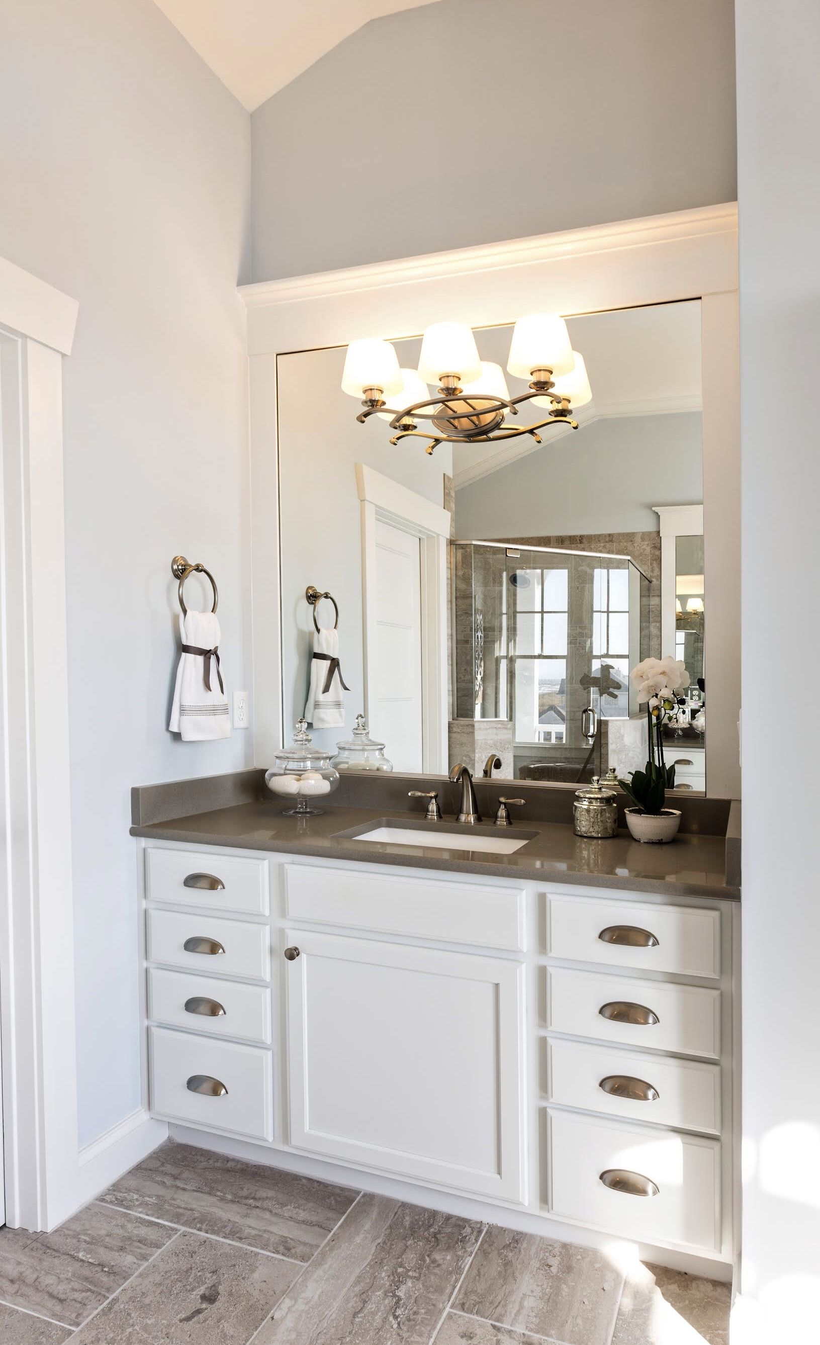 Dazzle A New Traditional Luxurious Vanity Light Fixture Is Featured In This Susan Wilson Interiors Master Bedroo Progress Lighting Bath Vanities Wood Accents