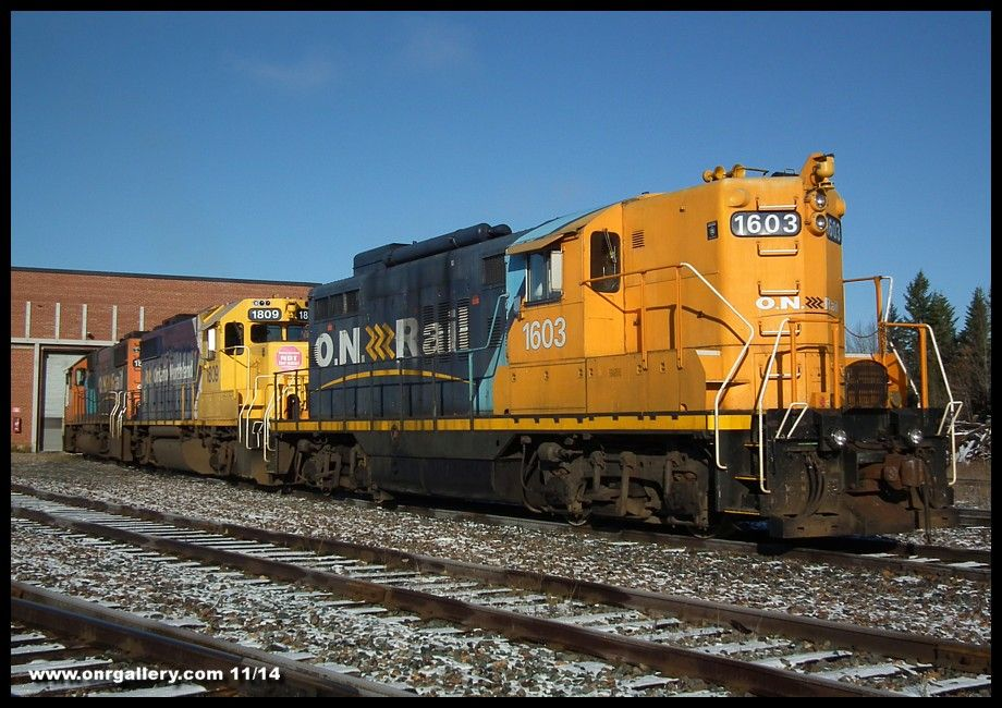 A shot from Cochrane Shops November 1st as GP9 1603, GP38-2 1809 and GP38-2 1806 greet the morning sun on 3 track.