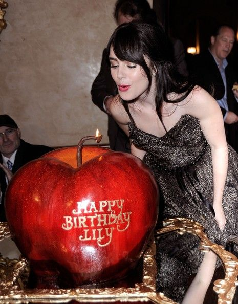 Lily Collins blows out the candle on her birthday cake at Relativity