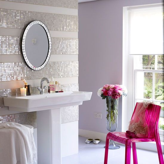 The iridescent glass tile stripes are so modern and really sparkle!  The fuschia accessories make the room POP with girlie-ness!  I think this is what Barbie's bathroom looks like these days...