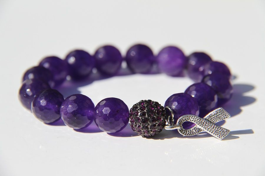 Purple Bracelet from Blest Bracelets. The bracelet is called the The Cure - Royalty for $35 dollars. (Breast Cancer Survivor)