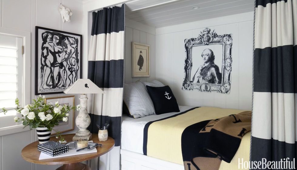 Mann-o-Print curtains frame aguest bedroom's nauticalberth with built-in drawers. The Louis XVI portrait is a photocopy paper assemblage by Woody Biggs.