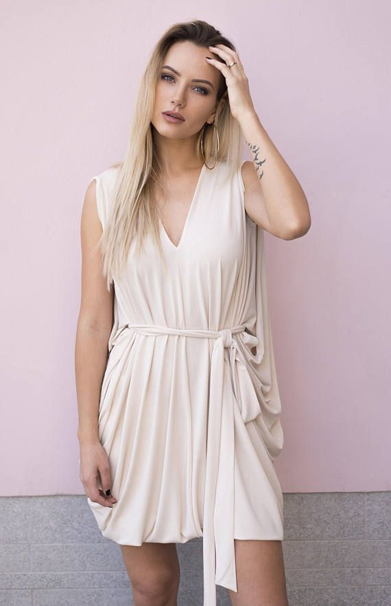 Creme Color Trendy Convertible Dress By Pulling Up The Bottom Part Of You Can Easily Transform It Into Mini Dr
