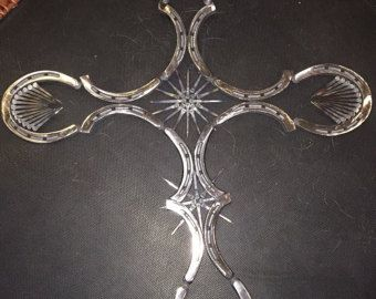 welding horseshoes together. beautiful cross made out of horseshoes and horseshoe nails. all welded together buffed to make it shiny. we can do in any color would look welding