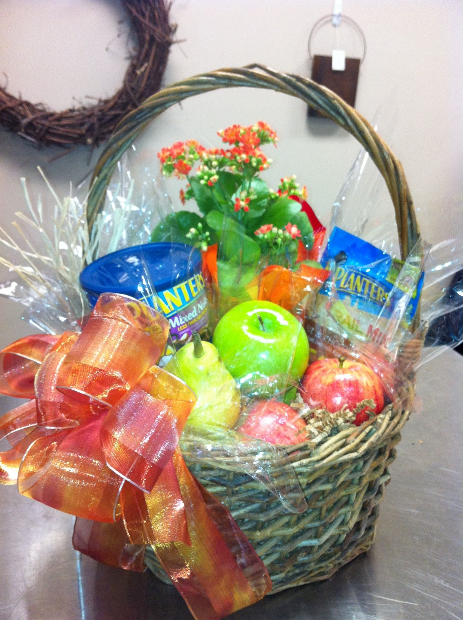 Healthy gift basket of Assorted Nuts, Apples and potted plant | FDB ...