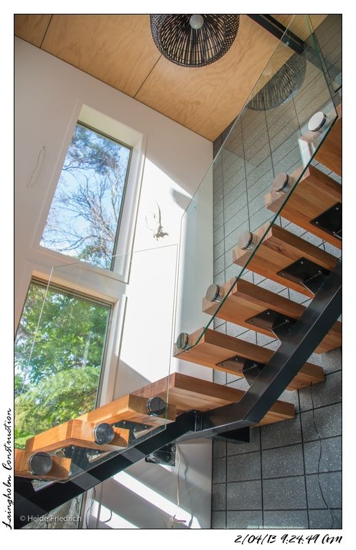 Floating Single Spine Staircase With Glass Banisters House